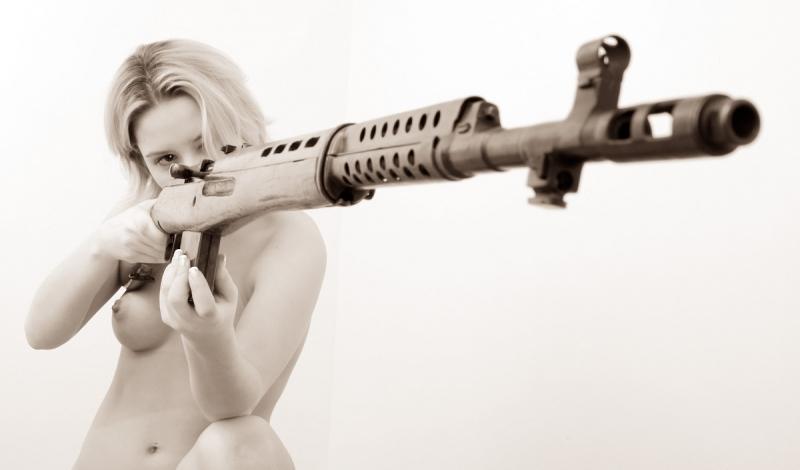 holding Naked guns girls