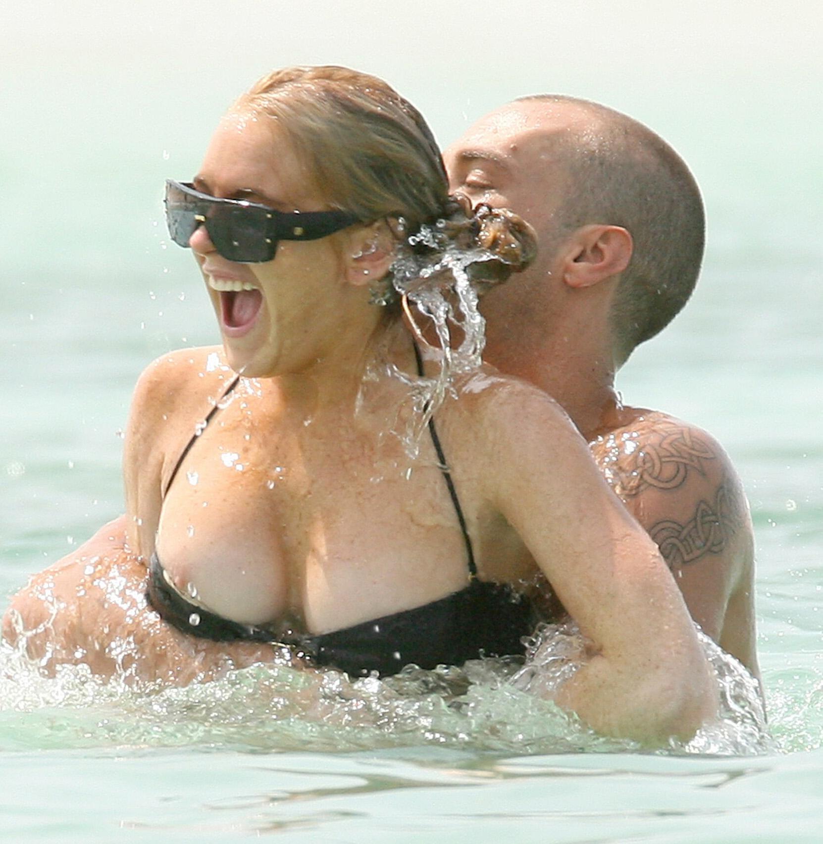 Lindsay Lohan's Boobs Slip Out Of Dress Imageing Liz Dick