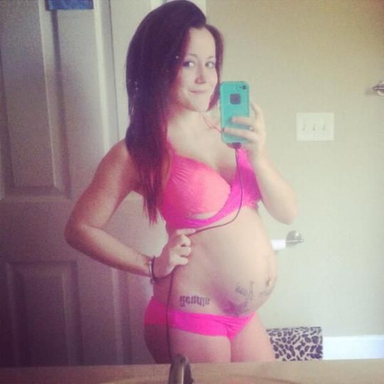 showing pregnant Teen