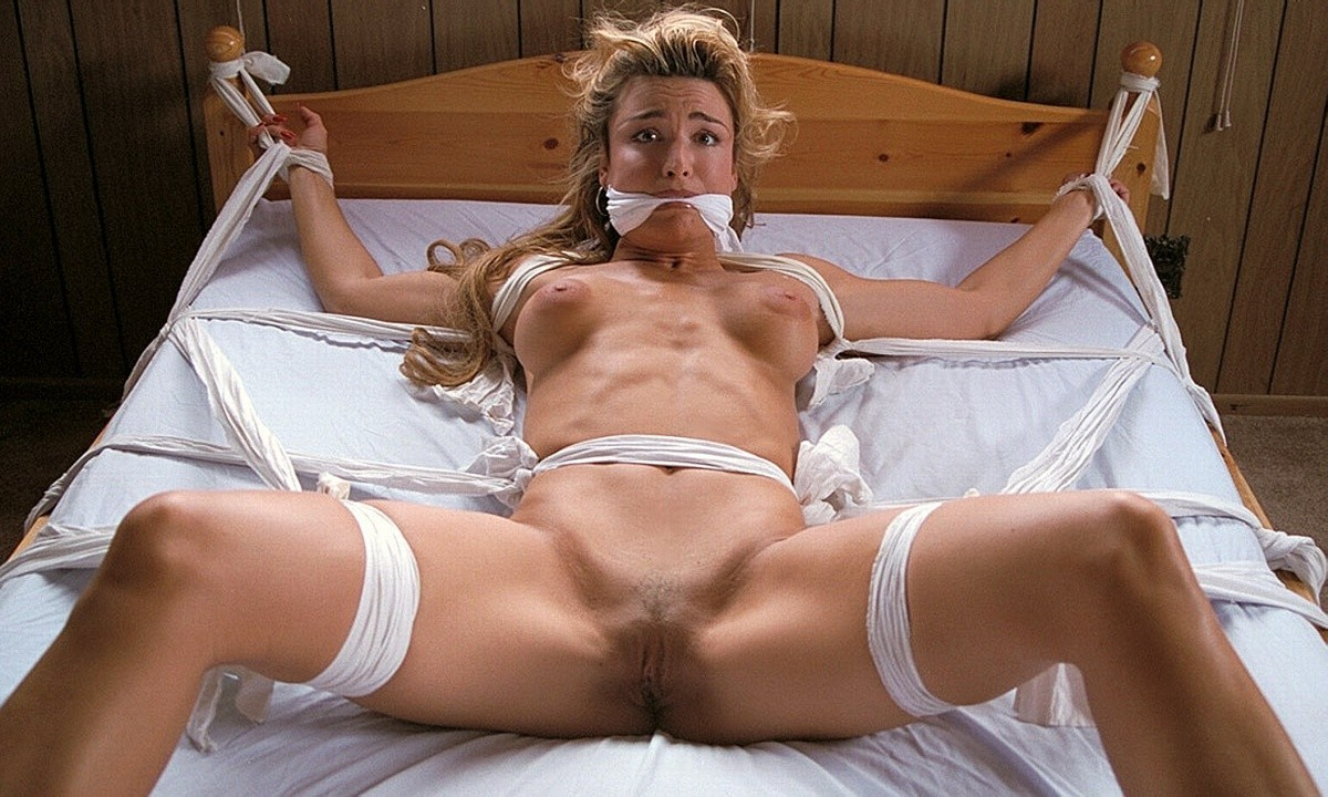 tied Mature legs bed spread on