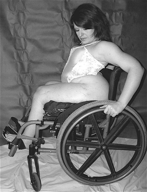 Naked women in wheelchairs