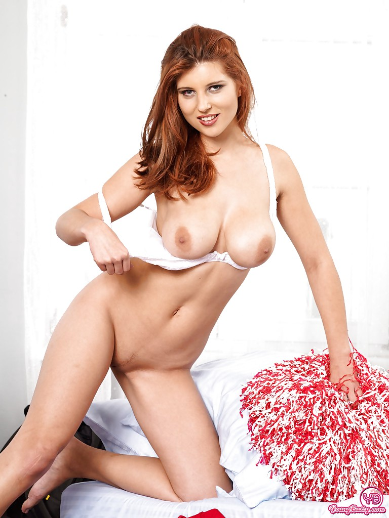 naked Redhead getting