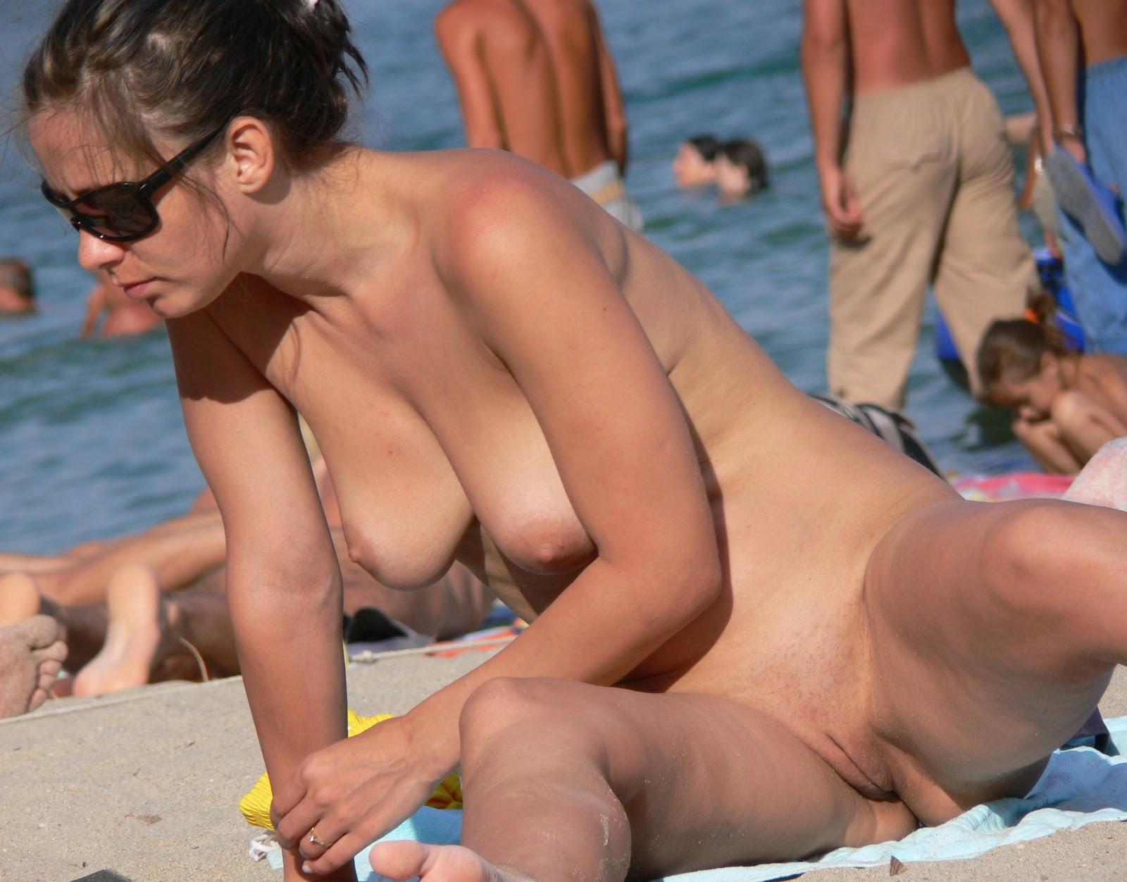 Voyeur fucks hot milf on the beach