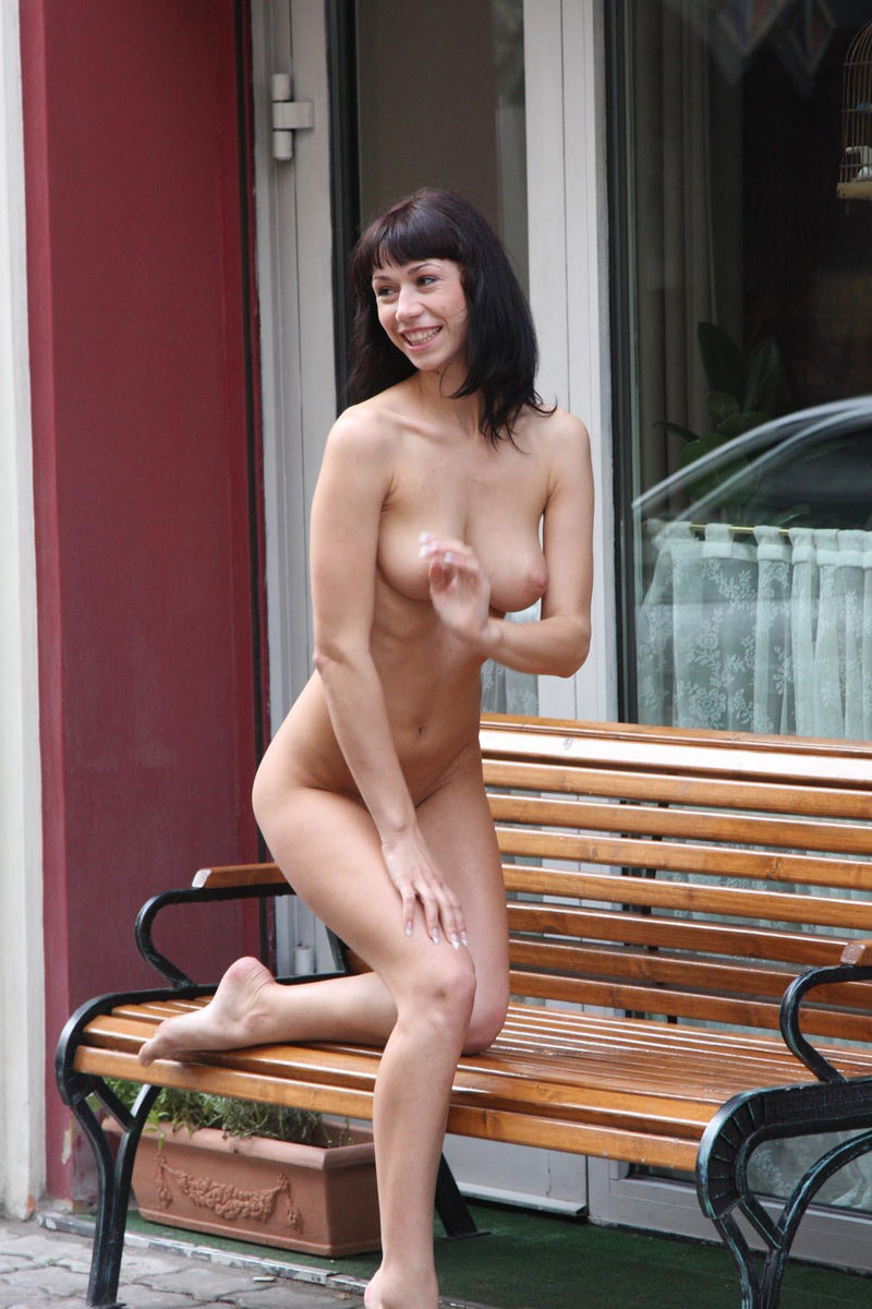 in Nude public pose