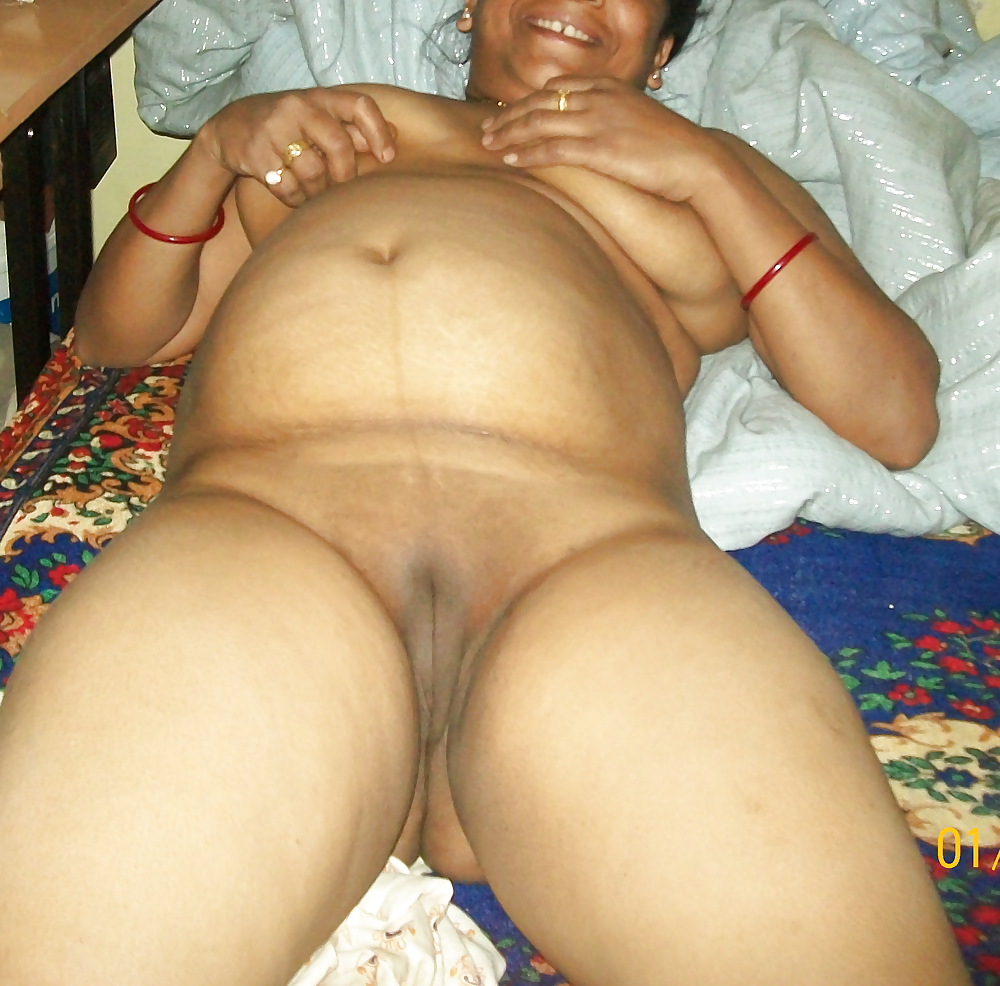 mature belly Indian on women laying